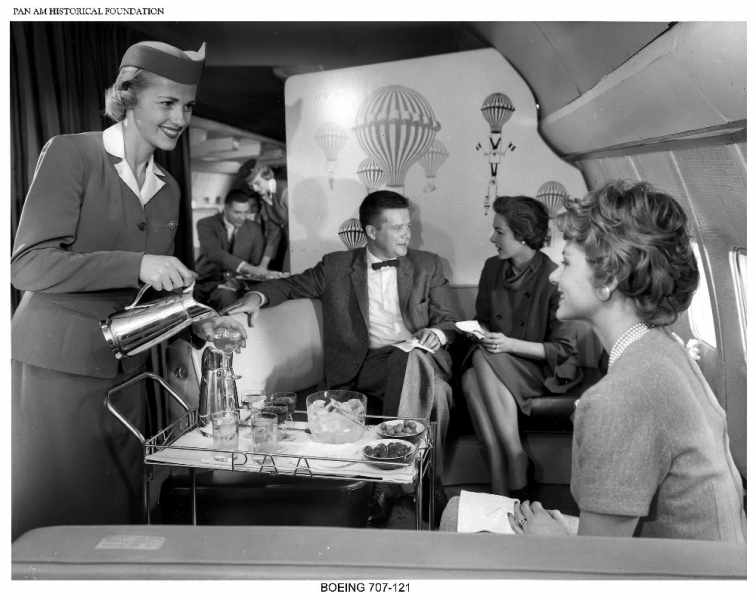 Pan_Am_Stewardess_serving_passengers_on_Boeing_707_jet_clipper-4137-900-600-100.jpg